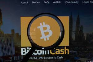 Magnifying glass over Bitcoin Cash logo