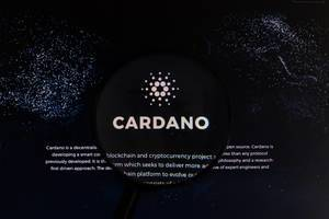 Magnifying glass over Cardano logo