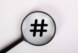 Magnifying glass with hashtag symbol