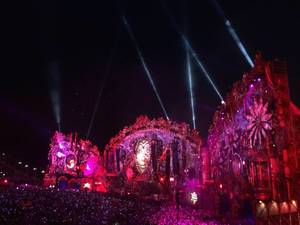 Main stage illuminated by pink light - Tomorrowland music festival 2014
