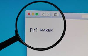 Maker logo under magnifying glass