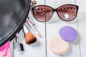 Makeup bag with brushes, sunglasses and makeup sponges