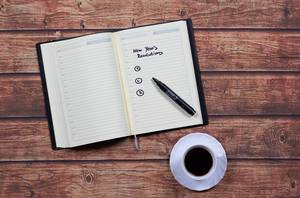 Making a list of resolutions for the new year in your notebook