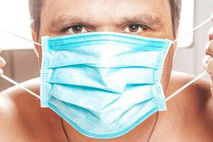 Male face with medical mask. The concept of prevention ill