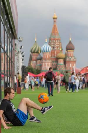 Man balancing a soccer ball on his foot