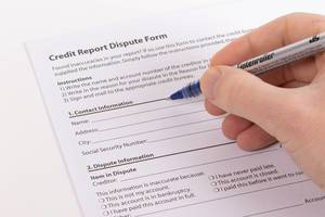 Man filling out Consumer Credit Report Dispute Form