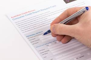 Man filling out Consumer Credit Report Request Form