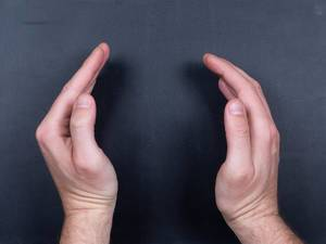 Man hands on black background with empy space (Flip 2019)