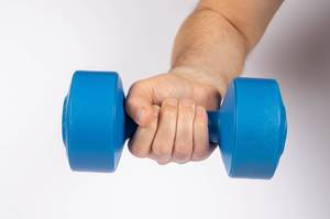 Man holding blue dumbbell isolated on white (Flip 2019)