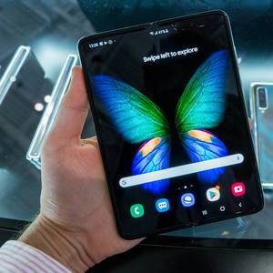 Man holding foldable smartphone Samsung