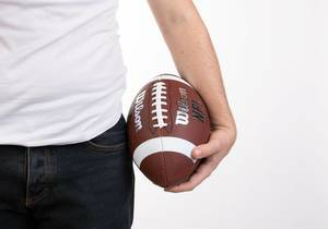Man holding football ball