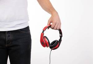 Man holding red headphones