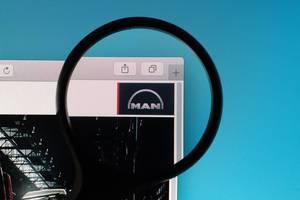 MAN logo under magnifying glass