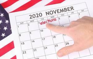 Man pointing date 3rd November 2020 marked in calendar.jpg