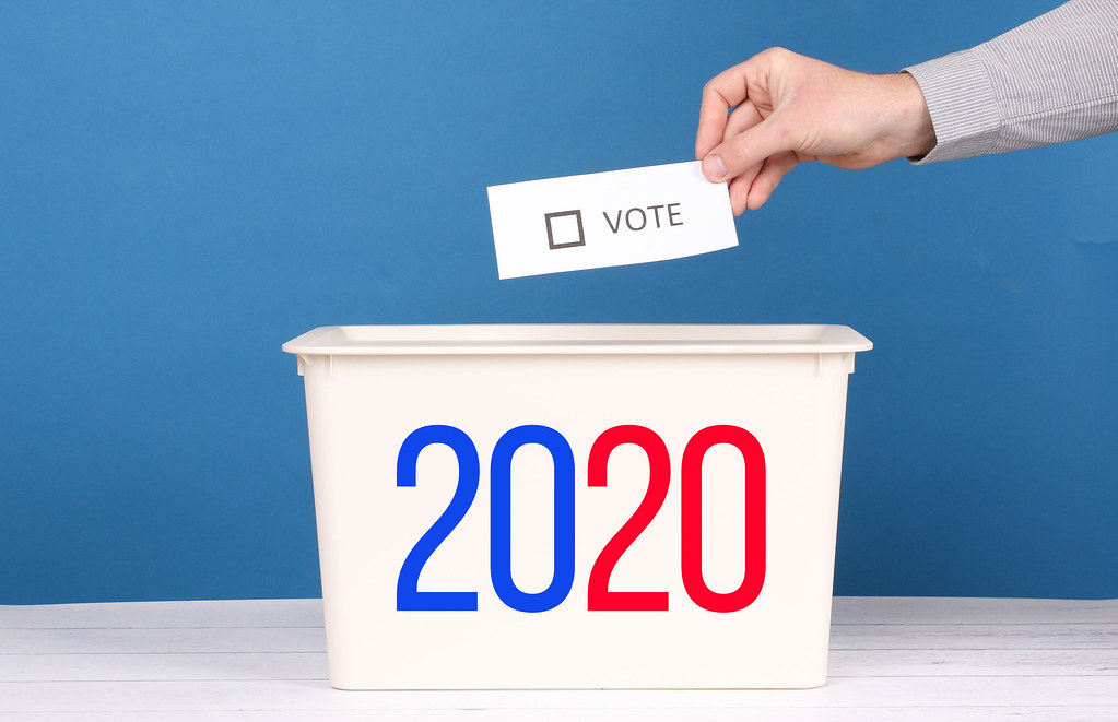 Man putting his vote in the ballot box for  Election 2020
