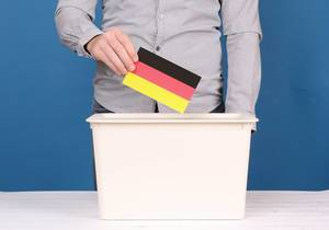 Man putting his vote in the ballot box in Germany