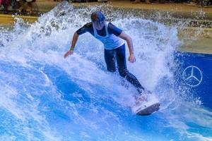 Man surfing in the Surfpool by Citywave at fair Boot Düsseldorf 2018