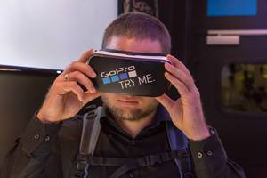 Man tasting the Samsung VR glasses with GoPro Sticker at Photokina Köln
