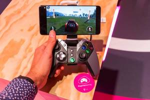 Man uses GameSir G4 Bluetooth Gamepad for Google Android Smartphones: multi-platform game controller for MagentaGaming