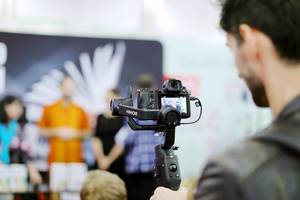 Man video recording using Ronin handheld stabilizer (Flip 2019)