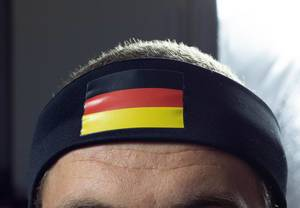 Man wearing head strap with German flag