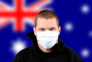 Man wearing protection face mask with flag of Australia