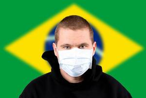 Man wearing protection face mask with flag of Brasil