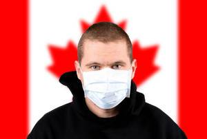 Man wearing protection face mask with flag of Canada