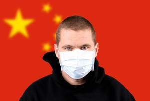 Man wearing protection face mask with flag of China
