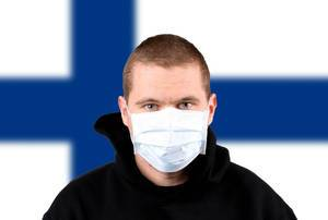 Man wearing protection face mask with flag of Finland