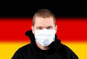 Man wearing protection face mask with flag of Germany