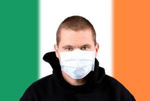 Man wearing protection face mask with flag of Ireland