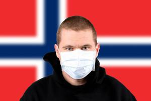 Man wearing protection face mask with flag of Norway