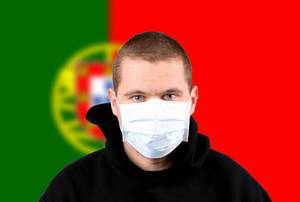 Man wearing protection face mask with flag of Portugal