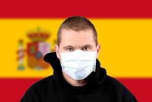 Man wearing protection face mask with flag of Spain
