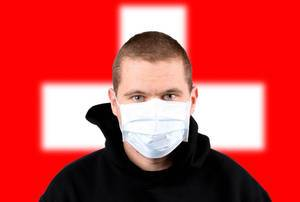 Man wearing protection face mask with flag of Switzerland
