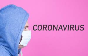 Man with medical flu mask adn Coronavirus text