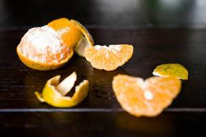 Mandarin orange segments on wooden table