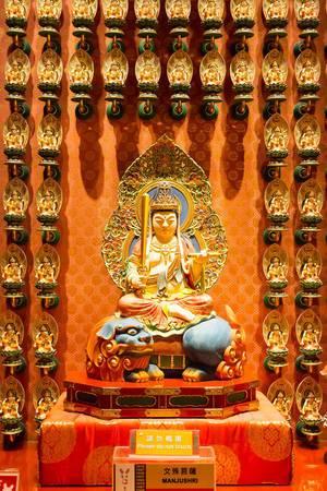 Manjushri-Statue in einem buddhistischen Tempel in Singapur