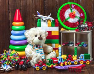 Many different Toys for Children presented in front of Wooden Background Christmas Presents