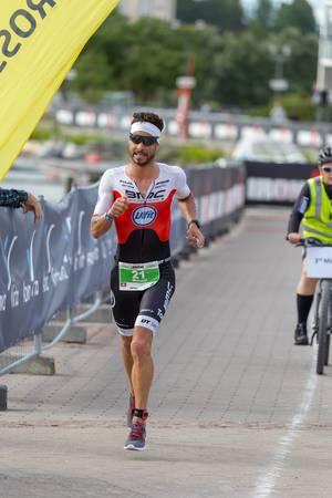 Marathon runner and top athlete Manuel Kueng takes third place at Ironman 70.3 Triathlon 2019 in Lahti, Finland