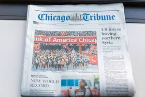 Marathon runners and new world record article on front page of Chicago Tribune Newspaper