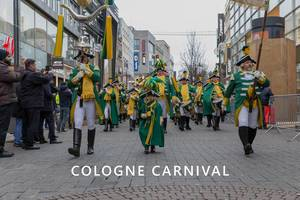"Marching band with children, men and woman in guard costumes during rose Monday at Kölner Karneval, walking through the streets, with the picture title ""Cologne Carnival"""