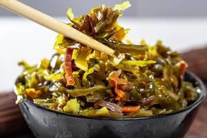 Marinated seaweed close-up with chopsticks