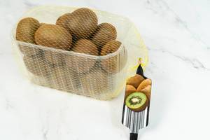 Market package with Kiwi fruit on the marble table (Flip 2019)