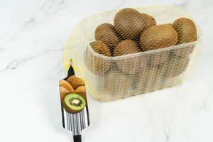 Market package with Kiwi fruit on the marble table