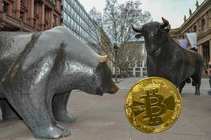 Market trends: a bitcoin with the bull and the bear in front of the Frankfurt Stock Exchange