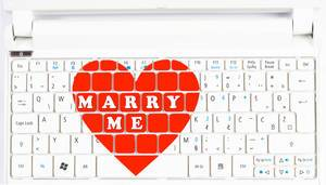 Marriage proposal and love concept for Valentine`s day on computer keyboard