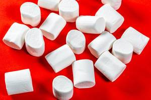 marshmallows on a red background. top view