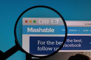 Mashable logo under magnifying glass